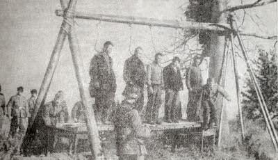 Казнь советских партизан фашистскими оккупантами. Фотография. 1941 г.